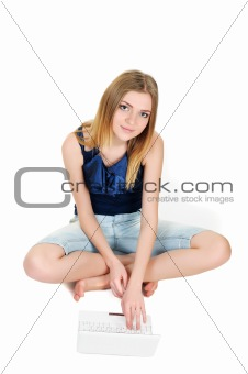 Beautiful young girl with laptop top view