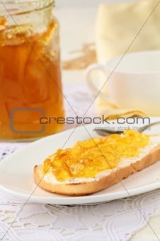 orange jam with toast on plate