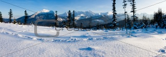Panoramic Tatra Mountains in winter scenery.