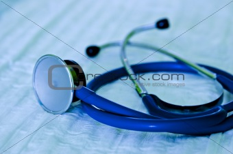 Shaded crome stethoscope lay on white workspace