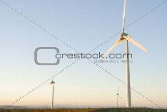 Three Wind Turbines at Dawn, UK.