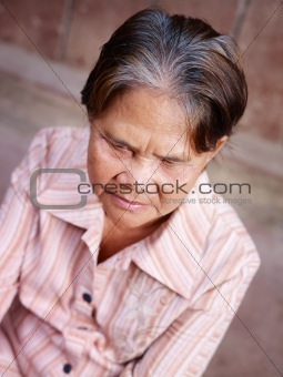 Portrait of old asian woman looking at camera
