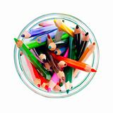 colored pencils in a clear glass jar. top view