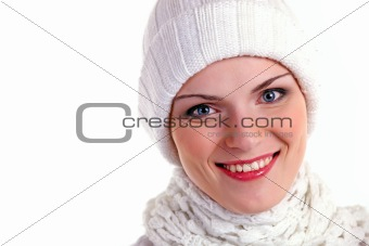 Beautiful cheerful girl in winter cap