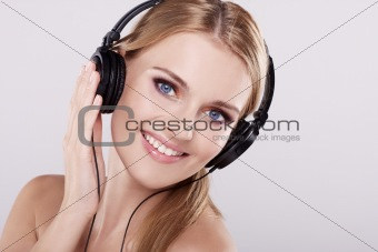 Portrait of happy young woman with headphones listening to music
