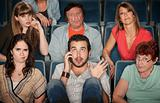 Man On Phone In Theater
