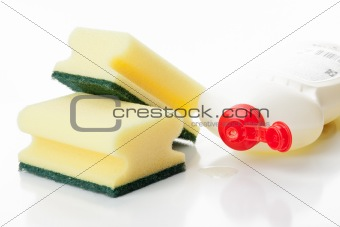 Yellow kitchen sponges and bottle of dishwashing liquid