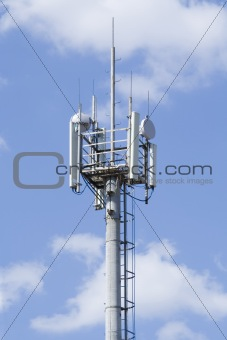 High transmitter tower against blue sky