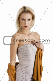 blond girl in elegant dress, her left hand is on the chest