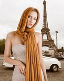 blond girl in elegant dress, she has the scarf on the head