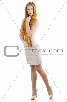 blond girl in elegant dress, she is turned of three quarters
