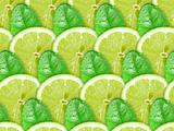 Background of lime slices and green leaf