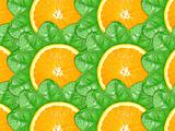 Background of orange slices and green leaf