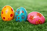 Colored eggs on lawn