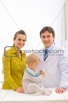 Portrait of pediatrician doctor and mother with baby on examination