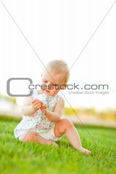 Baby playing on grass
