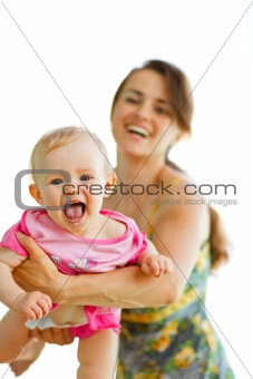Happy baby playing with mother