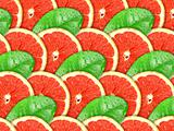Background of grapefruit slices and green leaf