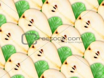 Background of pear slices and green leaf