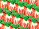 Background of strawberry slices and green leaf