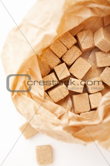 brown sugar cubes in sugar paper bag