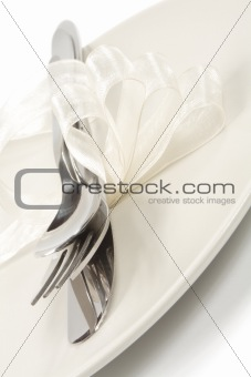 cutlery with white ribbon
