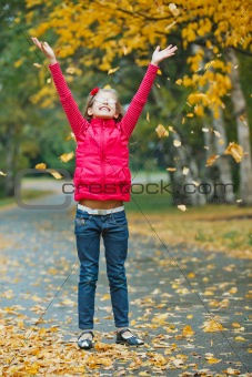Cute girl walking in the autumn park