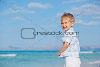 Little cute boy on the beach
