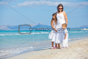 Young mother with her two kids on beach vacation