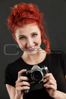 Redhead holding a camera