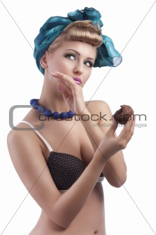 blond young girl eating sweet