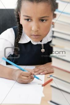 African American School Girl Writing In Class