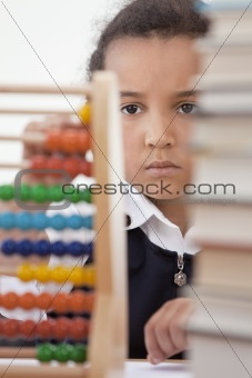 African American School Girl In Class Using Abacus