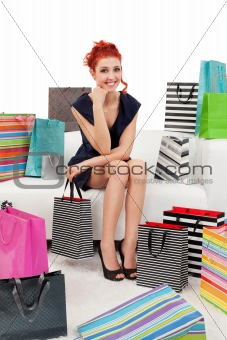 Beautiful woman surrounded with bags