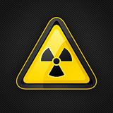 Hazard warning triangle radioactive sign on a metal surface