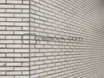 old wall with square worn ceramic white tiles