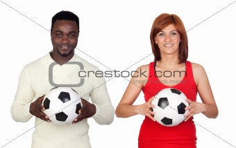 Beautiful redhead girl and attractive african men with a soccer