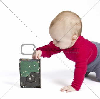 young child in white background with hard drive