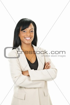 Smiling black businesswoman with arms crossed