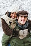 Couple having fun outside in winter