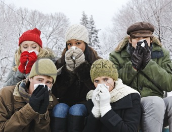 Group of friends with colds outside in winter