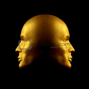 Two-faced gold head statue