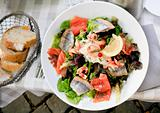 lunch  - plate of big salad with with salmon and herring