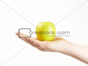 Apple in the palm og childs hand