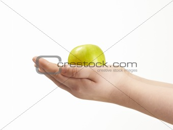 Apple in the palms og childs hands