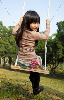 little girl on the swing