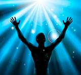 Spiritual man with arms raised up concept