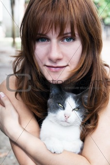 A beautiful young brunette and a cat