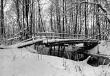 Winter landscape with small river and foot-path.