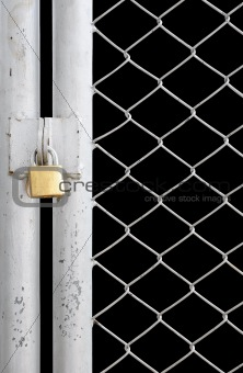 chain link fence and metal door with lock isolated on black